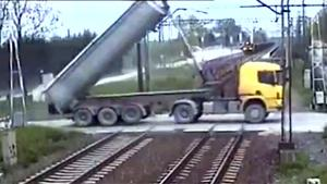 Truck Crosses Railroad With Dumper Up