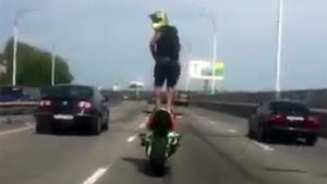 Crazy Biker Standsing On His Motorbike