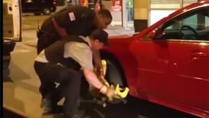Security Guard Drives Off With Boot On Wheel