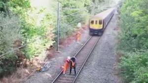 Sick Rescue In Front Of Oncoming Train