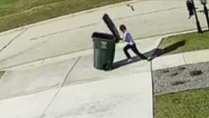 Kid Has Fight With Garbage Bin