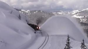 Snow Plow Train Coming Through