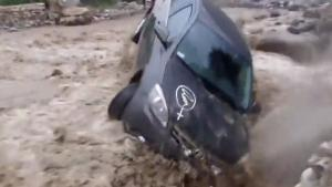 Man Tries To Cross Mud Flood In Car