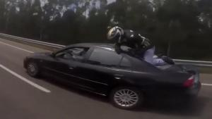 Biker Crashing Into Back Of Car