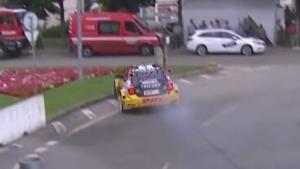 Race Car Crashes Against Fire Brigade