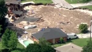 Sinkhole Makes Two Homes Disappear
