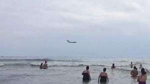MIG-17 Makes Low Pass On Beach