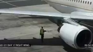 Man Walks Behind Running Jet Engine