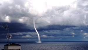 Cool Waterspout Over Lake